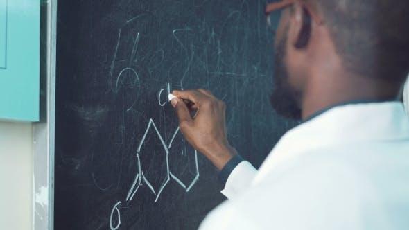 Thumbnail for Student Writing a Formula