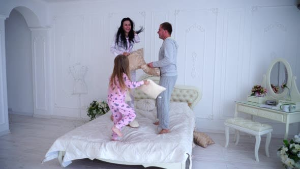 Thumbnail for Portrait of Family Fighting Pillows, Jumping on