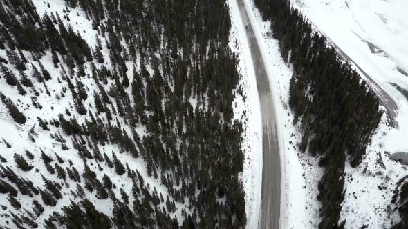 Thumbnail for Car Driving on Winter Road in Mountains During Snow Storm