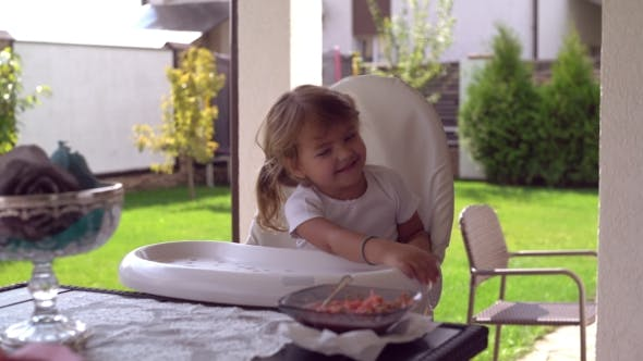 Thumbnail for Cute Baby Sitting on High Chair for Feeding