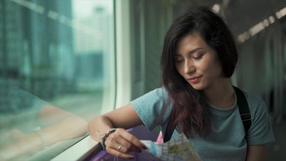 Thumbnail for Girl Travelling in Subway and Checking Map