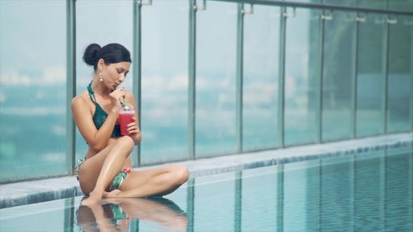 Thumbnail for Girl Drinking Fresh Smoothie Near the Pool