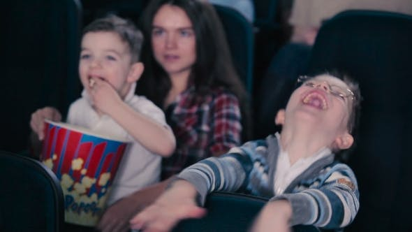 Thumbnail for The Boy in Glasses Are Watching the Movie in the Cinema