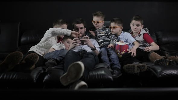 Thumbnail for Children Are Watching the Dad Play on the Phone