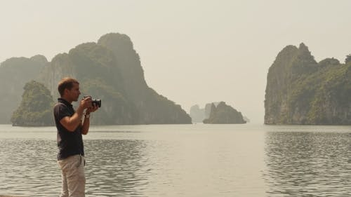 Photographer Photographing the Nature of Ha Long Bay