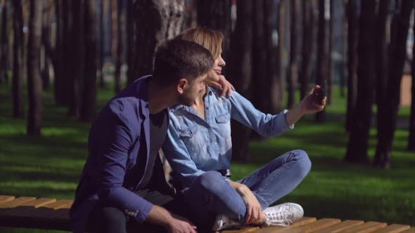 Thumbnail for Couple Take Selfie Photo in Park.