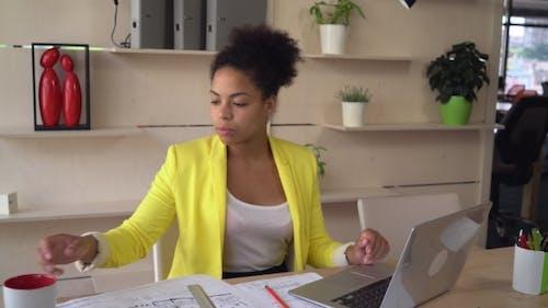 Mulatto Businesswoman in Office.