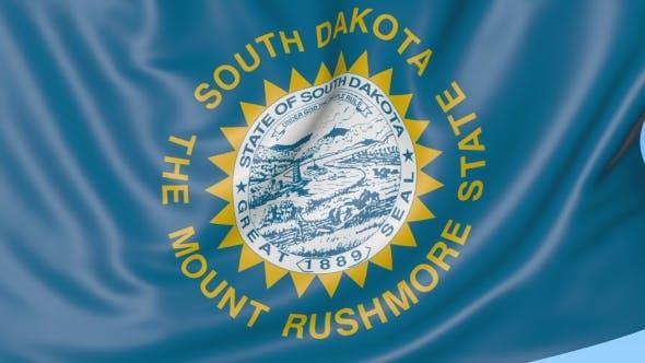 Waving Flag of South Dakota State Against Blue Sky