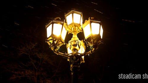 Lamp And Snow Night