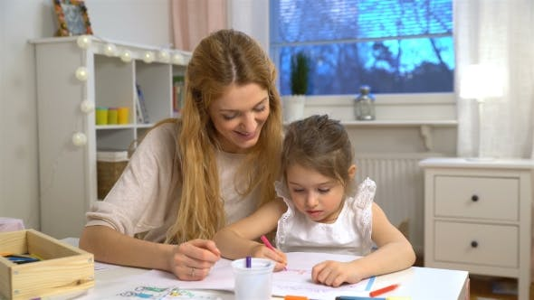 Thumbnail for Young Attractive Mom Teaches Child the Alphabet