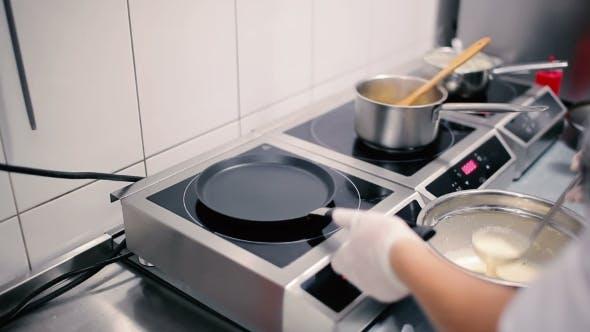 Thumbnail for Cook Gaining Batter Ladle.