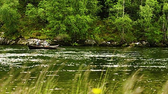 Mature Men Fishing On The Nordic River