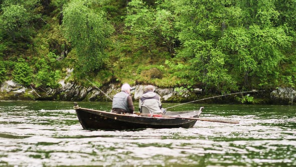 Thumbnail for Old Men Sitting In A Boat With A Fishing Rod