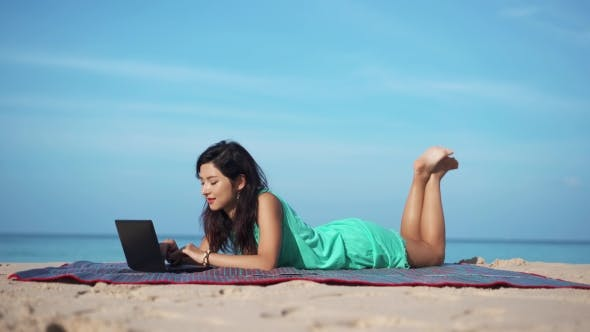 Thumbnail for Pretty Travel Girl with Laptop on the Summer Beach