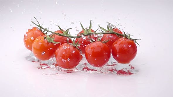 Cover Image for A Several Ripe Tomatoes are Falling on the Table.