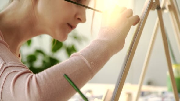 Thumbnail for Pretty Smiling Young Woman Drawing a Picture with Poster Paint. Front View on Drawing Girl with