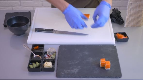 Thumbnail for - the Cook Put a Small Pieces of Sushi on a Black Square Plate