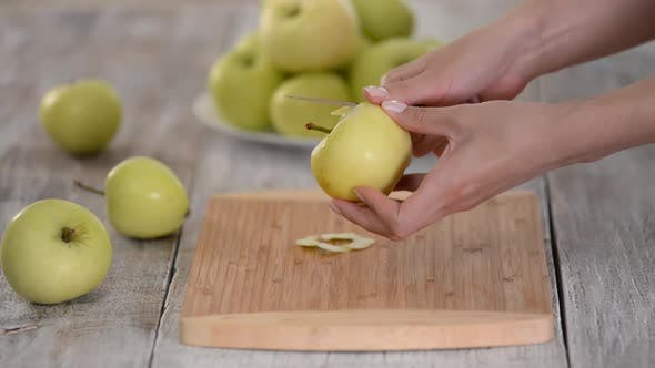 Thumbnail for Hands of the Cook Peel a Green Apple with a Knife