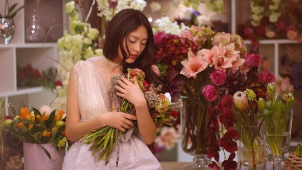 Woman and Flowers. Asian Girl with Bouquet