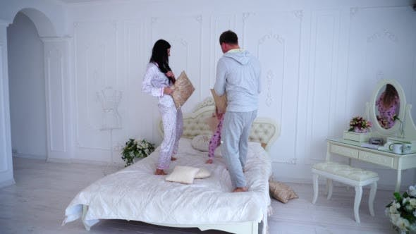 Thumbnail for Family Jumping and Fooling Around in Bed, Husband