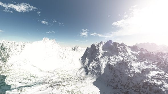 Thumbnail for Loop Mountains in Snow and Clouds at Blue Sky