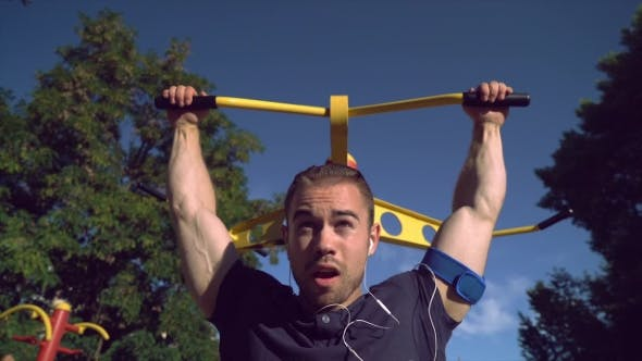 Thumbnail for A Muscular Man Is Pulling Himself Up in the Park.