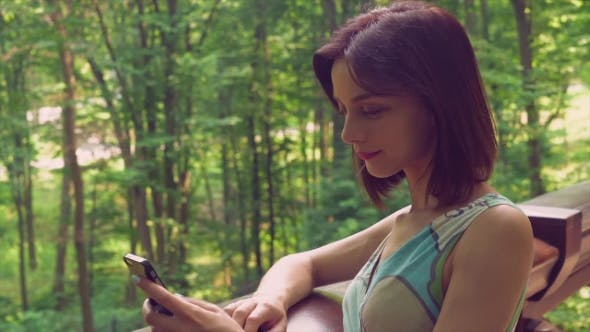 Thumbnail for A Brunette Girl Is Texting.