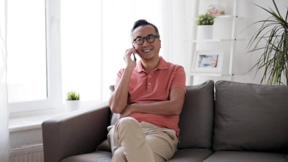Thumbnail for Happy Man Calling on Smartphone at Home 6
