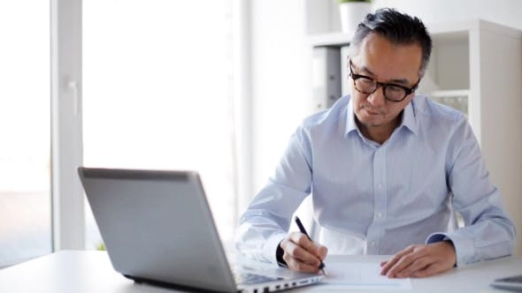 Thumbnail for Businessman with Laptop and Papers at Office 27