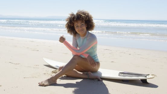 Thumbnail for Happy Female Sitting on a Surfboard