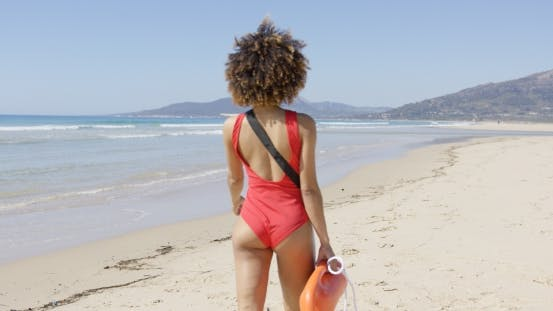 Cover Image for Female Lifeguard Goes Along Beach
