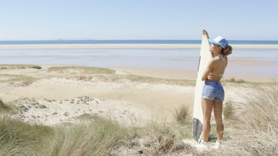 Thumbnail for Female with Surf Admiring Waterscape