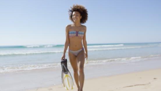 Thumbnail for Female Holding Flippers on Beach