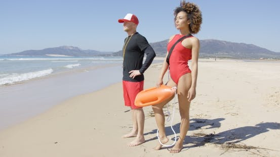 Thumbnail for Female and Male Lifeguards Posing on Beach