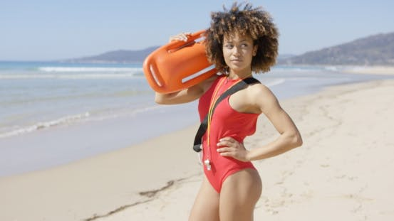 Thumbnail for Female Posing with Rescue Float on Beach