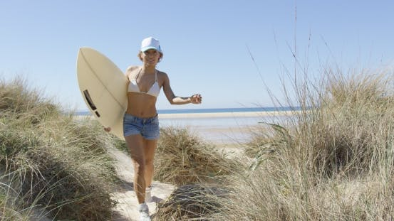 Woman Running with the Surfboard