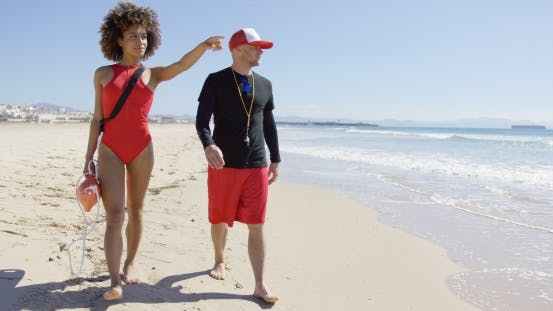 Thumbnail for Female Pointing Into Distance on Beach