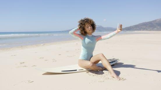 Thumbnail for Female Taking Selfie on Sea Background