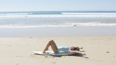 Young Woman on a Surfboard