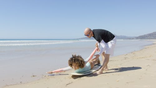 The Instructor with Female Surfer