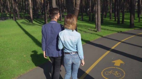 Thumbnail for A Cute Couple Is Walking Along the Path in the Forest.