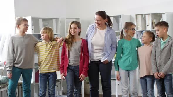 Thumbnail for Six Teenagers and Female Teacher Smiling for Camera
