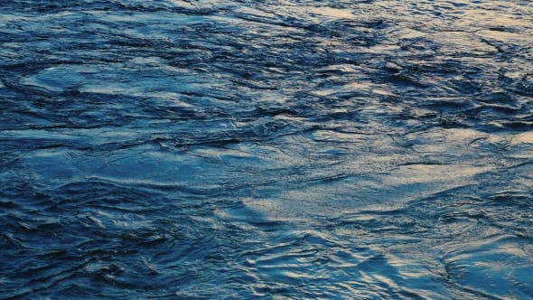 Thumbnail for Dark Blue Water Surface with Moving Ripple and Air Bubbles.