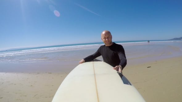 Thumbnail for Smiling Surfer Walking Out of Sea