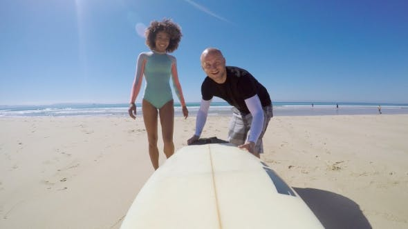 Smiling People with Surfboard