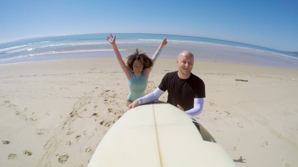Thumbnail for Cheerful Couple with Surfboard