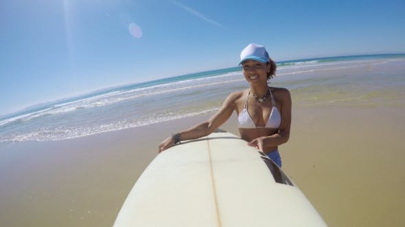 Smiling Woman with Surfboard