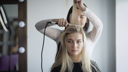 Professional Stylists Working on a New and Fashionable Shape for Its Rich Client