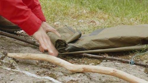Girl Folds Tent