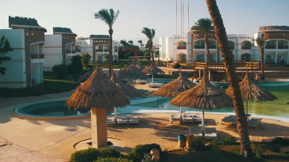 Thumbnail for Sunny Hotel Resort with Blue Pool, Palm Trees and Sunbeds in Egypt